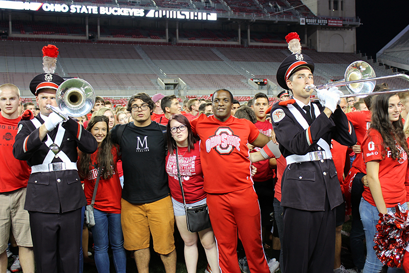 Students stand with members of the OSU marching band and OSU cheerleaders during the 2015 Buckeye Kick-Off event held at Ohio Stadium on August 27. Credit: Michael Huson / Campus Editor