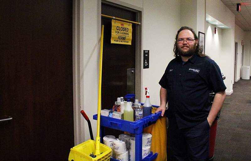 Wyatt Ward poses for a photo during a shift on Feb. 18th at the Avenue Library. Credit: Francis Pellicciaro