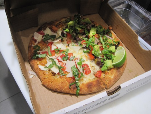 "A half bruschetta and half ""Tres Amigos"" personal pizza from Brenz Pizza. Credit: Hannah Herner / Lantern reporter"