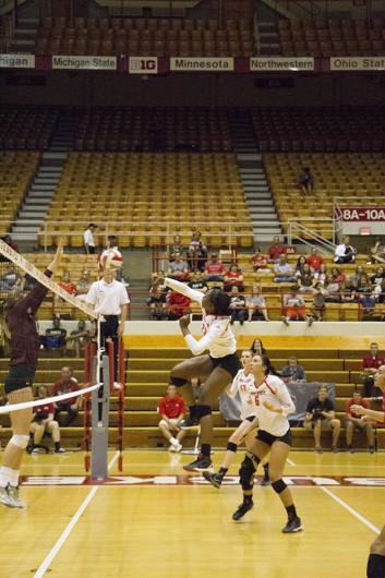 OSU middle blocker Tyler Richardson (23) spikes the ball at the OSU vs. Minnesota women's volleybal game on Wednesday, Sept. 23, 2015. Credit: Massarah Mikati