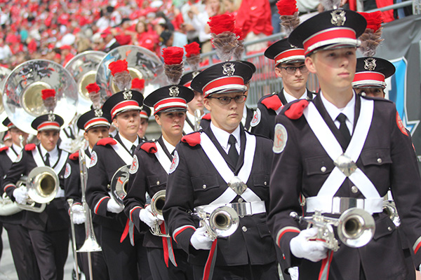 Members of the OSU marching band get ready for a performance on Sept. 12 at Ohio Stadium. Credit: Samantha Hollingshead / Photo Editor