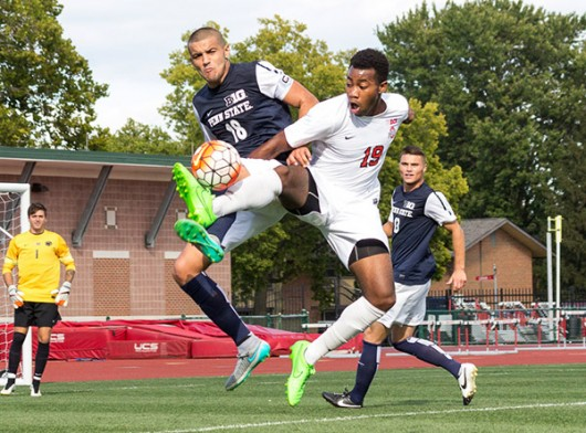 OSU sophomore forward Marcus McCrary (19) and Penn State redshirt freshman defender Dani Marks (18) fight for a ball during a game on Sept. 20 at Jesse Owens Memorial Stadium. OSU tied 1-1. Credit: Ed Momot