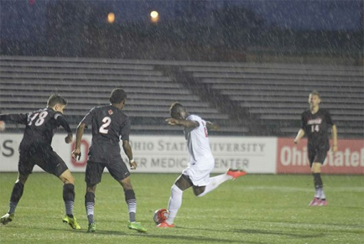 OSU junior forward Yaw Amankwa (23) attempts a shot during a game against Louisville on Sept. 29 at Jesse Owens Memorial Stadium. OSU won 1-0. Credit: Breanna Williams / Lantern Photographer