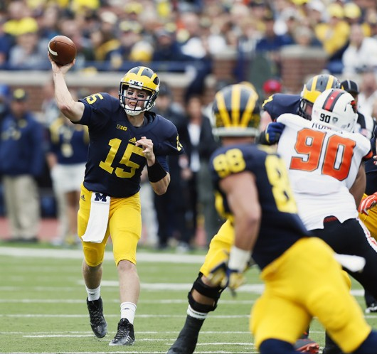 Michigan quarterback Jake Rudock (15) completes pass to tight end Jake Butt (88) in the second quarter against Oregon State at Michigan Stadium in Ann Arbor, Michigan, on Sept. 12. Michigan won, 35-7. Credit: Courtesy of TNS