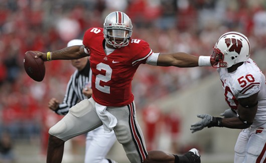 Then-OSU quarterback Terrelle Pryor tries to get away from Wisconsin's Brien Schofield during the fourth quarter of their NCAA college football game at The Ohio Stadium, Saturday, October 10, 2009 at Ohio Stadium. Credit: Courtesy of TNS