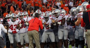 Coach Urban Meyer and members of OSU football team before a game against Virginia Tech on September 7 in Blacksburg, Virginia. Credit: Samantha Hollingshead / Photo Editor