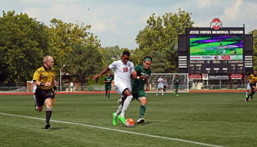 OSU Sophomore forward Marcus McCrary (19) dribbles the ball as Binghamton junior back Zach Galluzzo (4) pursues during an August 30. match at Jesse Owens Memorial Stadium. OSU lost 1-0. Photo Credit: Muyao Shen / Assist. Photo Editor