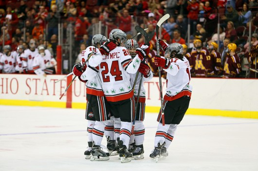 Members of the OSU Men's Hockey team celebrate during a March 7 game at the Schottenstein Center. OSU won, 5-2. Credit: Lantern File Photo