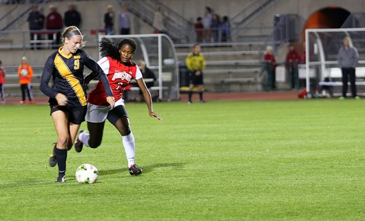 Then-sophomore Nichelle Prince (7) fights for a ball during a match Oct. 24, 2014 against Iowa at Jesse Owens Memorial Stadium. Credit: Lantern File Photo