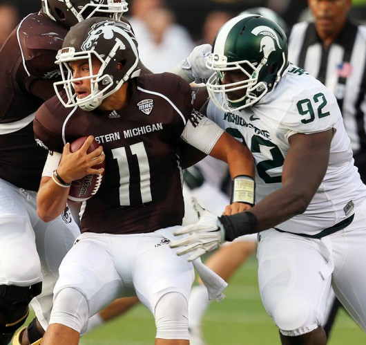 Michigan State's Joel Heath (92) sacks Western Michigan quarterback Zach Terrell (11) during the first half at Waldo Stadium in Kalamazoo, Michigan, on Sept. 4. Credit: Courtesy of TNS