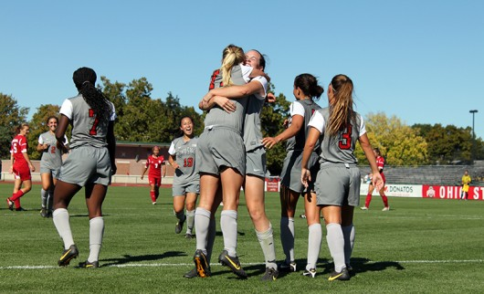 OSU women's soccer players celebrate during a game against Indiana on Sept. 26, 2014. Credit: Lantern File Photo