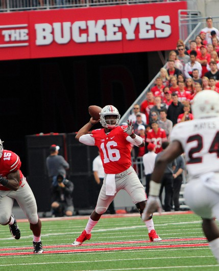 OSU redshirt sophomore quarterback J.T. Barrett (16) prepares to throw the ball during a game against Northern Illinois on Sept. 19 at Ohio Stadium. OSU won 20-13. Credit: Samantha Hollingshead / Photo Editor