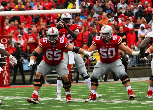 OSU redshirt junior offensive lineman Pat Elflein (65) and senior center Jacoby Boren (50) guard during a game against Northern Illinois on Sept. 19 at Ohio Stadium. Credit: Samantha Hollingshead / Photo Editor