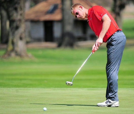 Redshirt-junior Michael Bernard roles a putt towards the hole during one of OSU's matches in 2014. Courtesy of OSU athletics