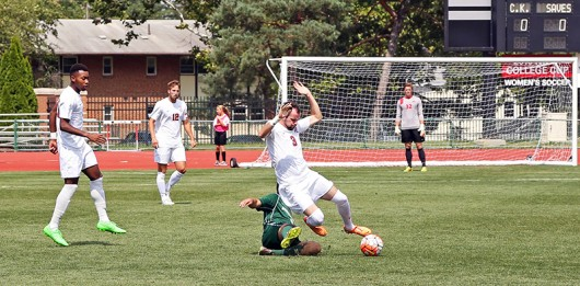 Binghamton junior forward Alex Varkatzas (9) slides into OSU senior midfielder Kyle Culbertson (3) for the ball during an August 30. match at Jesse Owens Memorial Stadium. OSU lost 0-1. Photo Credit: Muyao Shen / Assist. Photo Editor