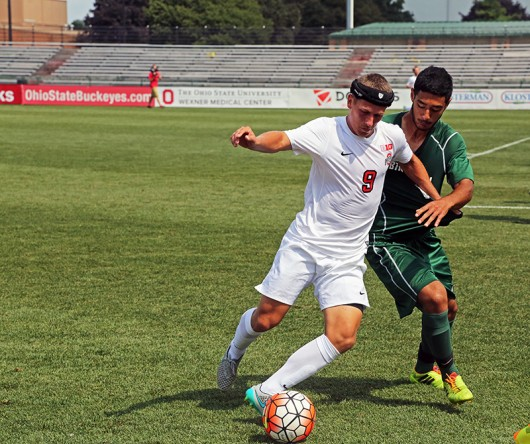 OSU junior forward Danny Jensen (9) dribbles the ball as Binghamton junior back Shervin Mohajeri (12) pursues during an August 30. match at Jesse Owens Memorial Stadium. OSU lost, 0-1. Photo Credit: Muyao Shen / Assist. Photo Editor