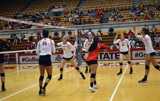 Members of OSU womens volleyball team celebrate after a play during a game against Florida State on September 6 at St. John's Arena. Credit: Ashley Roudebush / For The Lantern