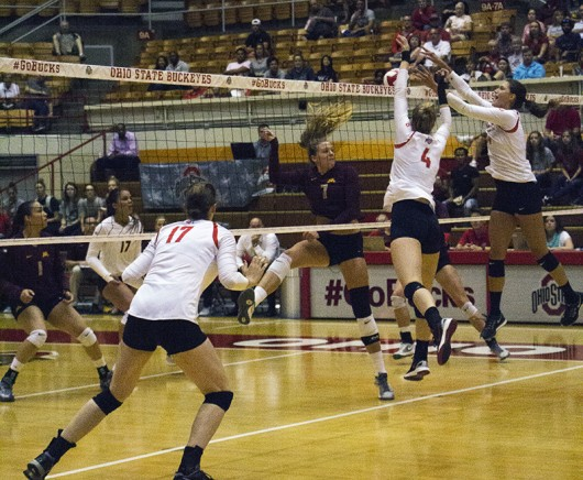 Members of the OSU women's volleyball team during a game against Minnesota on Sept. 23 at St. John's Arena. Credit: Massarah Mikati / Lantern Photographer