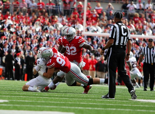 Junior defensive end Joey Bosa (97) tackles a Northern Illinois player during a game on Sept. 19. OSU won 20-13. Credit: Samantha Hollingshead / Photo Editor