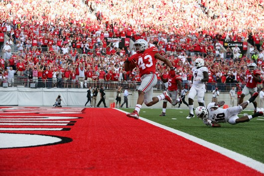 Redshirt sophomore linebacker Darron Lee steps into the end zone for a score during a game against Northern Illinois on Sept. 19. OSU won 20-13. Credit: Samantha Hollingshead / Photo Editor