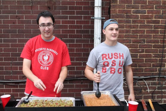 Jack McLaughlin and Casey Tesmer of the Buckeye Barbeque Club cooking the bacon green beans and bacon baked beans at their Bacon Day  on Sept. 25. Credit: Mason Swires / Lantern Reporter