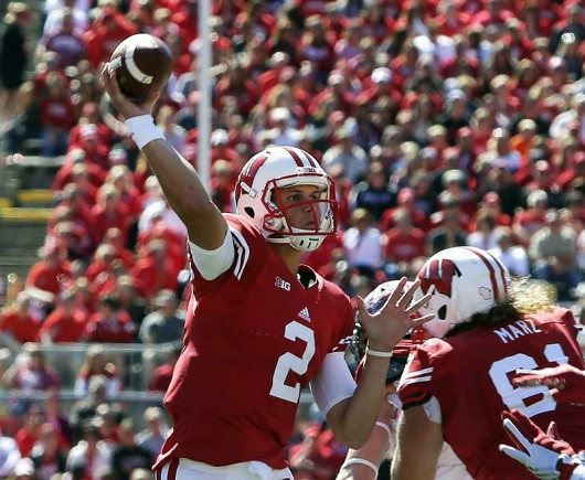 Wisconsin quarterback Joel Stave (2) throws a one of two first-half touchdown passes to wide receiver Robert Wheelwright at Camp Randall Stadium in Madison, Wisconsin, on Sept. 12. Wisconsin won, 58-0. Credit: Courtesy of TNS