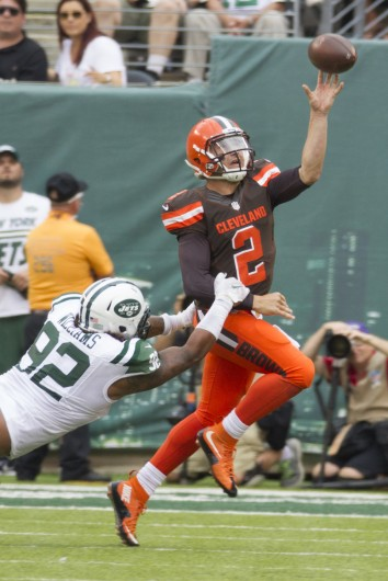 September 13, 2015 - East Rutherford, New Jersey, USA - Cleveland Browns quarterback JOHNNY MANZIEL (2) throws the ball away under pressure by New York Jets defensive end LEONARD WILLIAMS (92) during the NFL game between the Cleveland Browns and the New York Jets at MetLife Stadium in East Rutherford, New Jersey. The New York Jets won 31-10. Credit: Courtesy of TNS