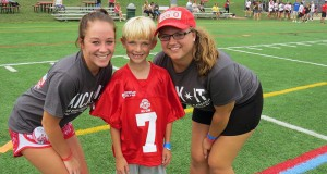 """Kick-it-all Star"" Reid Zupanc (middle) poses for a photo with Mary Stoll (left) and Sarah Scheiwiller during last year's kickball tournament. Credit: Courtesy of Katie Widman"