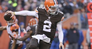 Cleveland rookie quarterback Johnny Manziel gets away from Cincinnati's Dre Kirkpatrick during the third quarter on Dec. 14, 2014, at FirstEnergy Stadium in Cleveland, Ohio. (Phil Masturzo/Akron Beacon Journal/TNS)