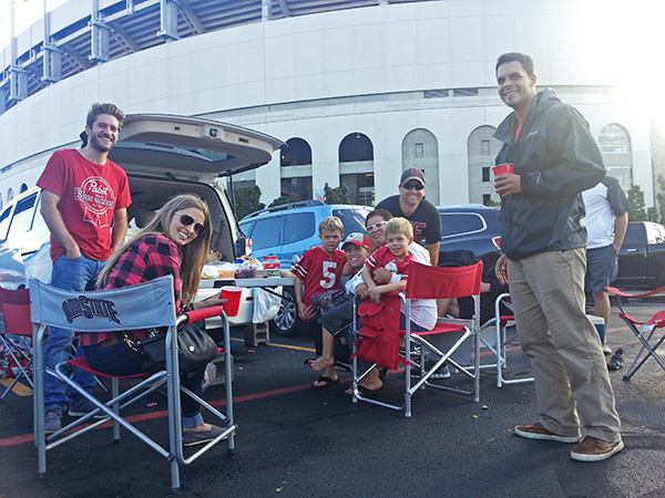 Tami Smith, an alumna, and her family tailgating at Ohio Stadium during the game against Northern Illinois University on Saturday, Sept. 18. Credit: Michael Huson / Campus Editor
