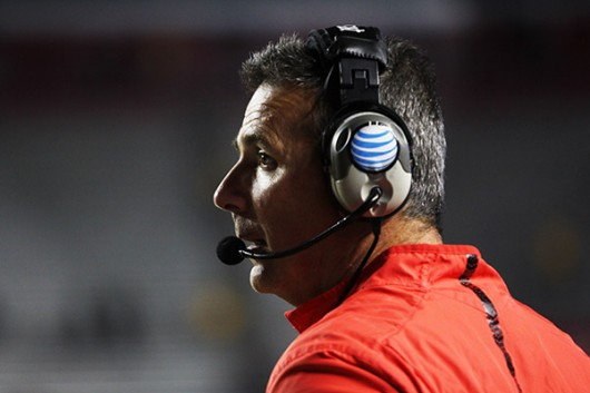 OSU coach Urban Meyer looks out toward the field during a game against Rutgers on Oct. 24. OSU won, 49-7. Credit: Samantha Hollingshead / Photo Editor
