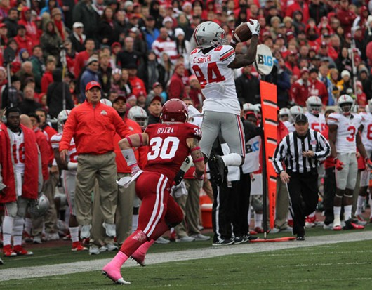 Redshirt senior wide receiver Corey Smith (84) goes up for a catch against Indiana on Oct. 3 in Bloomington, Indiana. OSU won 34-27. Credit: Samantha Hollingshead / Photo Editor