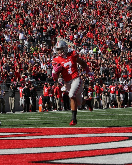 OSU redshirt sophomore H-back Jalin Marshall (7) runs into the end zone for a 48-yard touchdown reception during the third quarter. OSU won, 49-28. Credit: Samantha Hollingshead / Photo Editor