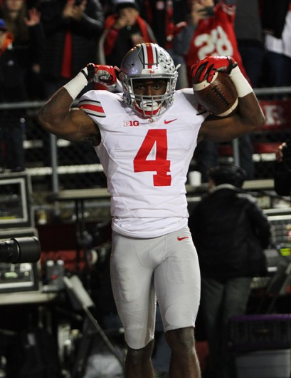 Sophomore H-back Curtis Samuel (4) poses after scoring a touchdown during Ohio State's 49-7 win against Rutgers on Oct. 24 in Piscataway, New Jersey. Credit: Samantha Hollingshead / Photo Editor