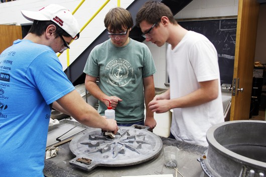 Engineer students work to clean and prepare the Foundry Members mold during their meeting on Tuesday, Oct. 7 in Watts Hall. Credit: Ian Bailey / Lantern Reporter
