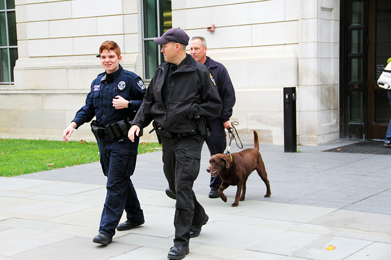OSU PD and bomb sniffing dogs were seen outside Thompson Library on Oct. 27. Police said they were there to answer questions for students and to walk around the area. Credit: Samantha Hollingshead | Photo Editor