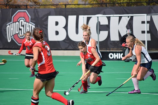 OSU redshirt sophomore midfield/back Carolina Vergroessen (28) runs with the ball while being trailed by California players during a field hockey game on Oct. 25, 2015, at Buckeye Varsity Field. OSU won 6-3. Credit: Robert Scarpinito / Copy Chief