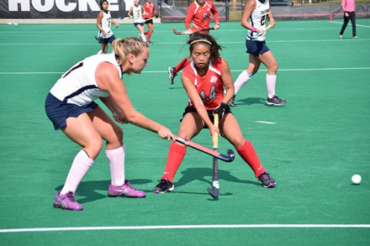 OSU freshman midfielder Hannah Scherpbier hits the ball away from California sophomore midfielder Paula Seibt during a game on Oct. 25, 2015, at Buckeye Varsity Field. Credit: Robert Scarpinito / Copy Chief