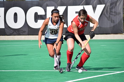 OSU sophomore midfield/back Carolina Vergroessen (28) tries to defend the ball from California freshman forward Janaye Sakkas (20) during a field hockey game on Oct. 25, 2015, at Buckeye Varsity Field. OSU won 6-3.
