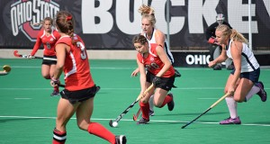 OSU redshirt sophomore midfield/back Carolina Vergroessen (28) runs with the ball while being trailed by California players during a field hockey game on Oct. 25, 2015, at Buckeye Varsity Field. OSU won 6-3.