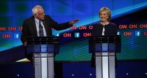 Oct. 13, 2015 - Las Vegas, Nevada, U.S. - BERNIE SANDERS, left, and HILLARY RODHAM CLINTON, on stage at the CNN moderated Democratic Presidential Debate. (Credit:  Josh Haner/NYT/Pool via ZUMA Wire)