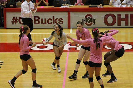 Members of the OSU women's volleyball team celebrate during a game against Iowa on Oct. 2 at St. John Arena. OSU won 3-2. Credit: Giustino Bovenzi / Lantern Photographer