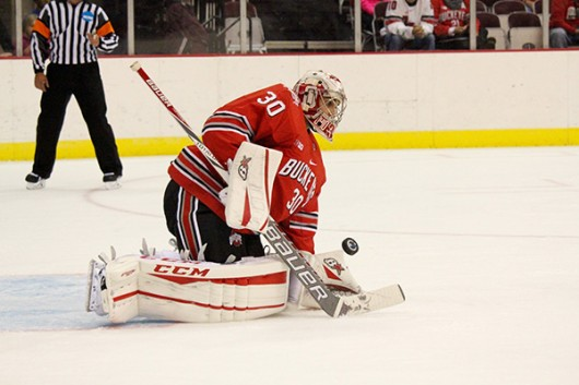 OSU junior goaltender Christian Frey stops a shot during an exhibition game against Brock on Oct. 3 at the Schottenstein Center. OSU won 4-0. Credit: Kaley Rentz / Asst. Sports Director