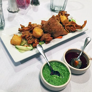 A vegetable platter served with fried octopus, a favorite menu item at The New Taj Mahal in the University District of Ohio State. Credit: Ian Bailey / Lantern Reporter