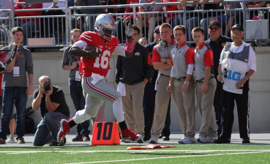OSU redshirt sophomore J.T. Barrett (16) runs down the sideline during a game against Maryland at Ohio Stadium on Oct. 10. OSU won, 49-28. Credit: Samantha Hollingshead / Photo Editor