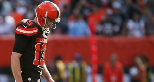 Cleveland quarterback Josh McCown hangs his head as he walks off the field after throwing an interception to Oakland safety Charles Woodson to end the Browns' late fourth quarter drive on Sunday, Sept. 27, 2015, at FirstEnergy Stadium in Cleveland, Ohio. (Ed Suba Jr./Akron Beacon Journal/TNS)