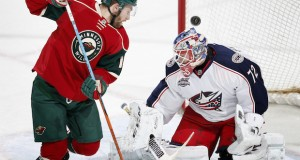 Columbus Blue Jackets goalie Sergei Bobrovsky (72) makes a save with Minnesota Wild's Jason Zucker (16) in front of the net during the second period on Jan. 19 at Xcel Energy Center in St. Paul, Minnesota. Credit: Courtesy of TNS