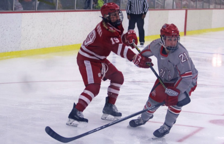 OSU then-sophomore defenseman Alexa Ranahan (21) skates away from a Wisconsin player during a game at the OSU Ice Rink on Feb. 13. OSU lost, 2-0. Credit: Lantern File Photo