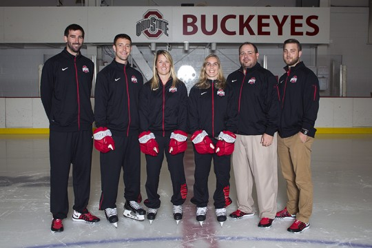 OSU women's ice hockey coaches including head coach Jenny Potter, third from right, pose for a picture. Credit: Courtesy of OSU Athletics