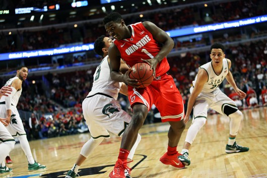 Then freshman forward Jae'Sean Tate (1) fights to dribble around a defender during a Big Ten Tournament quarterfinal game against Michigan State on March 13 in Chicago. OSU lost, 76-67. Credit: Lantern File Photo